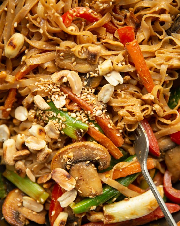 overhead shot of stir fry in wok with silver fork digging in