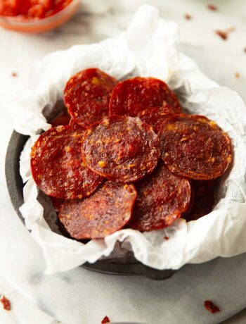 pepperoni chips in parchment paper in mini cast iron skillet