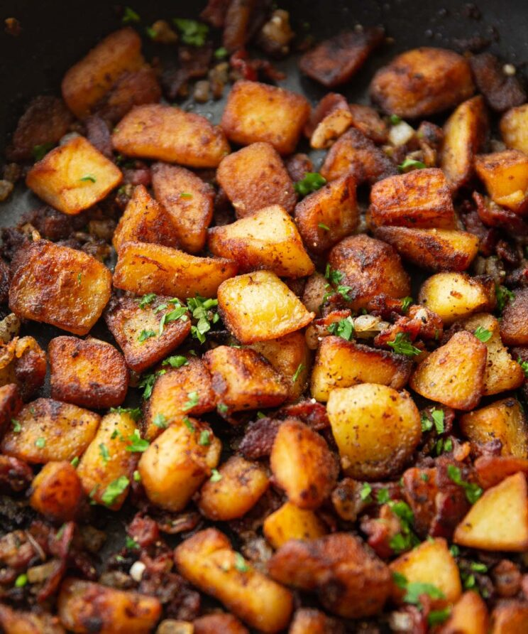 breakfast potatoes in large skillet garnished with fresh parsley