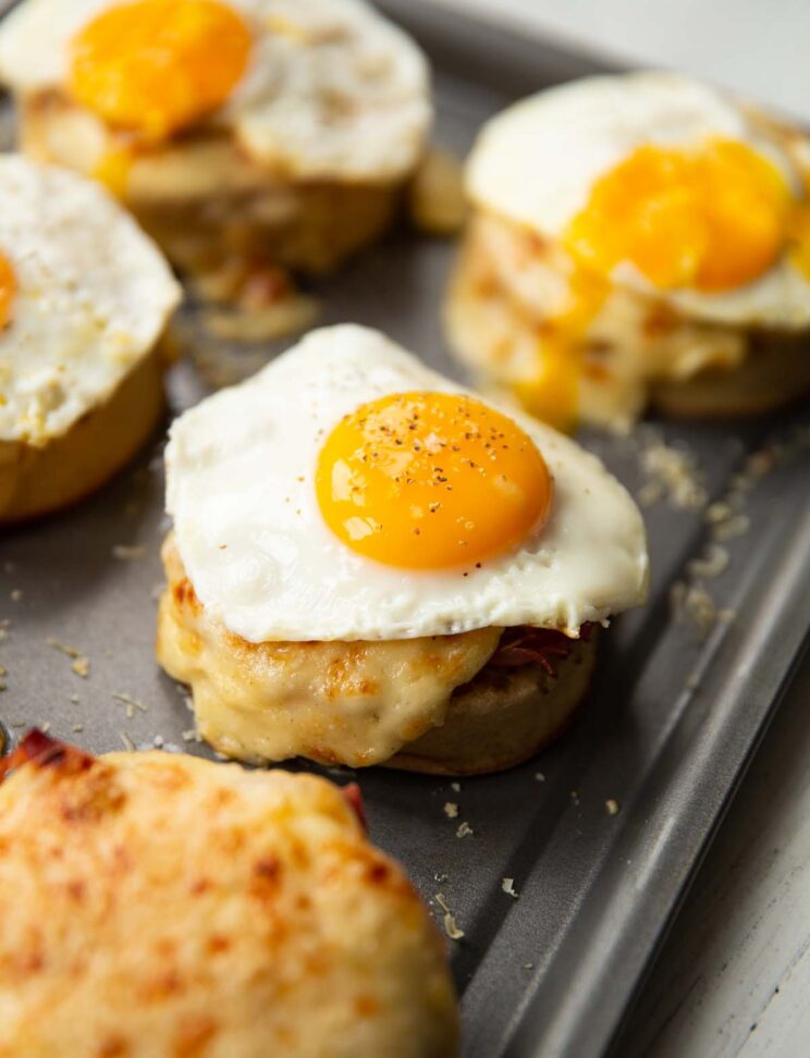 6 madame crumpets on baking tray served with fried egg on top