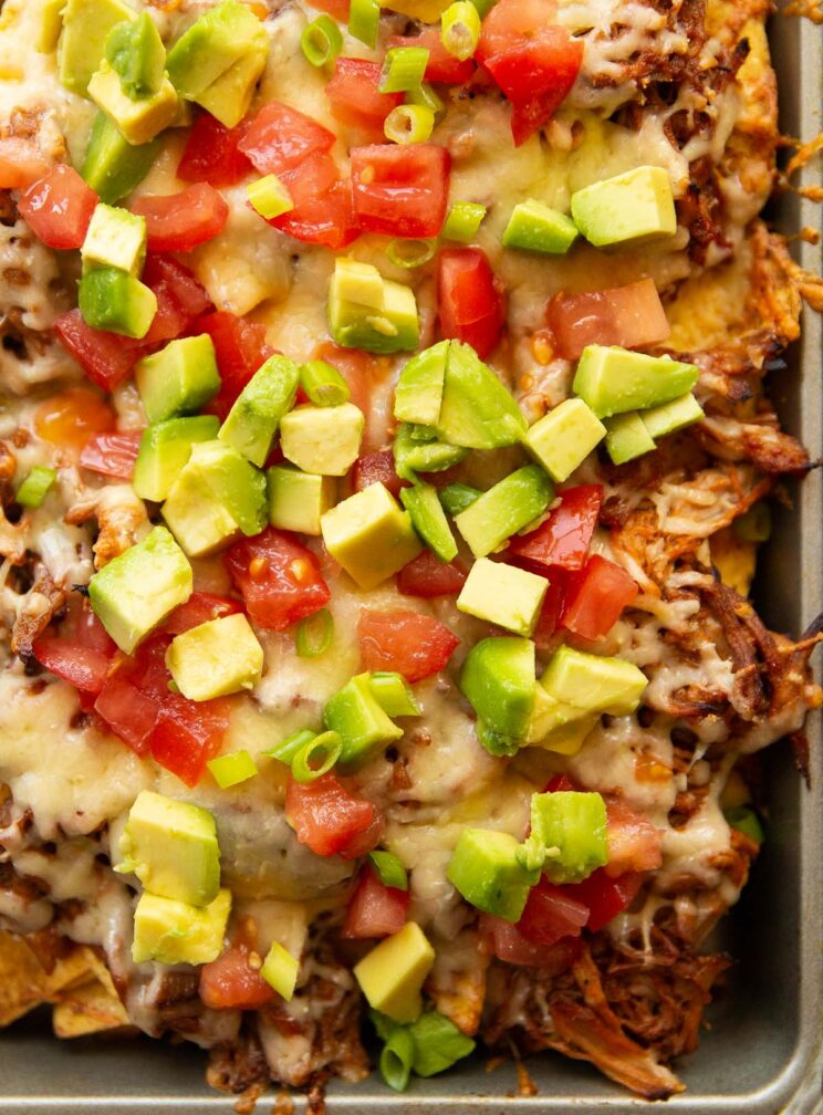 overhead shot of pulled pork nachos in silver baking tray